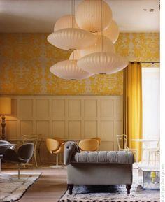 love the grey and yellow, panelling, swan chairs, etc