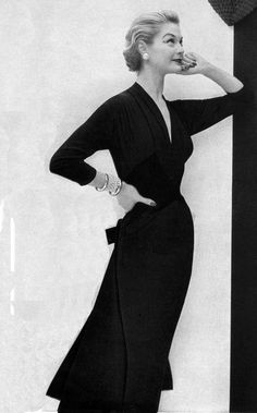 1954 (I just bought a dress that looks almost EXACTLY like this one, and I bought it in two colors.  Score!)