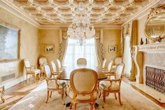 The dining room at the Dans Bois Crete Mansion features an octagonal coffered ceilingin gold leaf and crowned by a Baccarat chandelier. Reminiscent of the intricate craftsmanship of Florence's Palazzo Vecchio, the ceiling measures 18 inches thick.