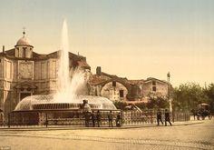 A group of individuals gaze into The Fountain of the Naiads in Piazza della Repubblica, wh...