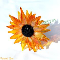 Hand Blown Gorgeous Glass Flowers! Beautiful black eyed susan made with a transparent yellow orange petals and a black eye.