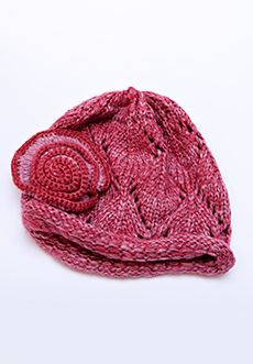 Homecoming Trunk Shows - Our most popular cap last year has made a comeback, this time is gorgeous new colors! Soft, marbled yarn lends depth and charm to this loose knit cap with a solid ribbed rolled edge.  A hand knit flower tops this knit cap off to keep you cozy and looking stylish. Comes in Kiwi, Graphite, and Plum.     - One size fits most   - 100% acrylic   - Hand wash and lay flat to dry   - Imported $25.00