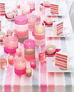 the striped  candles...fill with dollar tree white rocks half way and put in dollar candle.....super cute an chic!