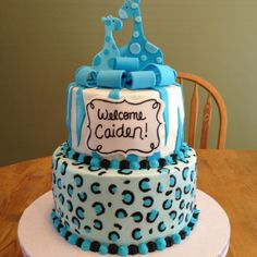 Baby shower cake. It's a boy! Buttercream cheetah print, fondant zebra stripes, bow, and giraffes.  Maybe we can do it in pink??