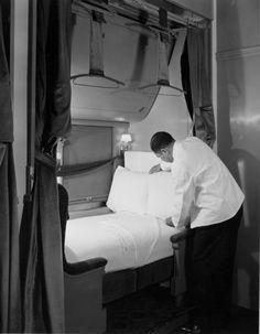 A Pullman porter preparing a traincar bed, 1940