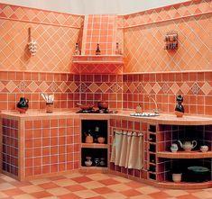 cocina pequeña de azulejos rústicos imitando los antiguos ladrillos/small kitchen with tiles imitating rustic old bricks