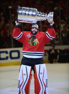 Chicago Blackhawks goalie Corey Crawford lifts the Stanley Cup Monday in the Stanley Cup Final Game 6 at the United Center in Chicago. Blackhawks Players, Blackhawks Jerseys, Chicago Blackhawks, Chicago Cubs, Hockey Mom, Hockey Teams, Hockey Players, Hockey Stuff, Sports Teams