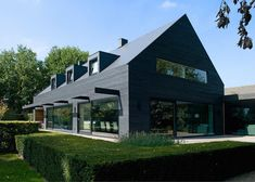 1960s Dutch House Went to the Dark Side and It's Glorious | Curbed. Black barn contemporary style home.