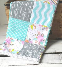 Baby girl blanket front is made of 100% cotton fabrics and has a modern patchwork design that features arrow, Aztec, and floral prints in primarily teal, pink, and gray shades. Beautiful spring time colors or would make a great Easter gift! Backing fabric is ultra soft plush minky dot. Blanket measures 28x34 inches, which makes it perfect for use as a receiving blanket and for snuggling baby. ***THIS BLANKET IS READY TO SHIP! However, it is also available as a made to order quilt in the drop…