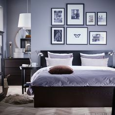 A black-brown MALM bed frame with a grey comforter and white striped pillows. A side table on each side of the bed with gallery images of plants and butterflies hanging above the bed. Ikea Lit Malm, Cama Malm Ikea, Brown Furniture, Bedroom Furniture, Bedroom Decor, Ikea Bedroom Sets, Hack Ikea, Malm Bed Frame, Ikea Home