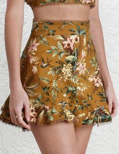 Tropicale Flutter Short, from our Resort Swim 17 collection, in Mustard Floral linen. Frill short with frill panel at cuff. Picot scallop trim throughout waistband and frill hem. Invisible zip closure at centre back.