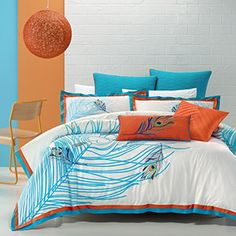 The crisp, white background of Aiyana forms a perfect canvas to display the colour, beauty and mysteries of the fabled peacock feather. This whimsical design is enhanced by the colourful embroideries and the bold, tailored finish in orange and peacock blue. A superbly quilted euro pillowcase and a striking, embroidered cushion cover complete the look. The quilt cover has button closure.