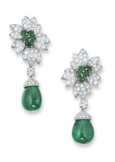 A PAIR OF EMERALD AND DIAMOND EAR PENDANTS, BY VAN CLEEF & ARPELS EACH SET WITH AN EMERALD DROP, JOINED TO THE BRILLIANT-CUT DIAMOND CAP, SUSPENDED FROM A SURMOUNT DESIGNED AS A BRILLIANT-CUT DIAMOND FLOWERHEAD WITH CIRCULAR-CUT EMERALD PISTILS, SPACED BY A BRILLIANT-CUT DIAMOND, MOUNTED IN 18K WHITE AND YELLOW GOLD, 5.8 CM LONG  SIGNED V.C.A. FOR VAN CLEEF & ARPELS, NO. N.Y. 39246