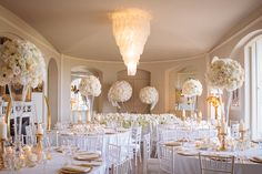 Beautiful table designs with tall blush and ivory floral centrepieces by Paula Rooney   Luxury Wedding at Aynhoe Park, Oxfordshire   Wedding Planner: Vanilla Rose Weddings, Oxford   Photography: Pippa MacKenzie