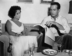 Elizabeth Taylor and Paul Newman going over the script on the set of Cat On a Hot Tin Roof (1958)