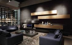 Masculine wall color and furniture works well with warm wood details #home #decor