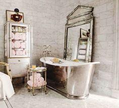 Ultra glamorous bathroom. Beautiful metal soaking tub looks great with standing mirror.