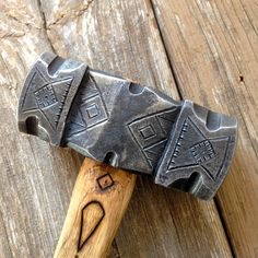 3.5 pound decorated rounding hammer.