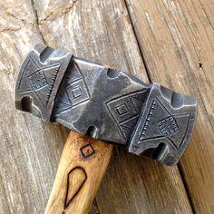 3.5 pound decorated rounding hammer.
