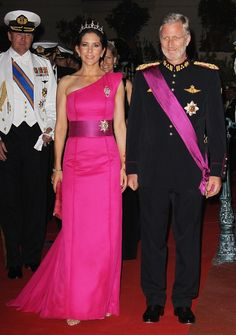 Crown Princess Mary of Denmark first wore the David Anderson gown in 2011 (pictured), escorted by King Philippe of Belgium on right, when she attended the wedding of Prince Albert and Charlene Wittstock in Monaco