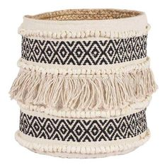 This decorative bohemia basket with tassels is the perfect touch of design and texture to add to any coastal or boho home.