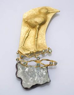 Linda Kindler Priest | Baby Stilt Leg: Two part brooch in 14k gold, faceted green sapphires, crystal aquamarine, and silver.  $4,891.00