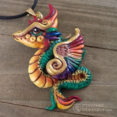 Rainbow dragon! I couldn't do up a feathered serpent design without painting at least one of them in the traditional rainbow-hued garb of the mythical Qeutzalcoatl.