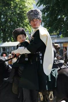 Circassian father in traditional dress with his little son