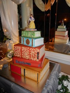 book cake.. nice for someone who loves reading!! Change the figurines on top though