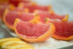 Margarita Granita blood orange jalapeño tequila ice served in an orange wedge, on a lime sugar bed