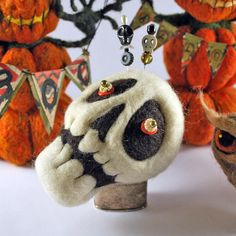 Needle felted skull soft sculpture pin cushion Halloween decoration with skull pins