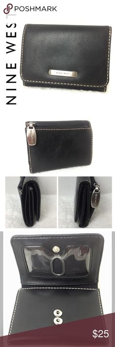 """Nine West Signature Tri-Fold Leather Wallet Nine West Signature Tri-Fold Leather Wallet in Classic Black with White Stitching and Brushed Silver Toned Hardware, 1  Exterior Zip Pocket, Leather/Nylon Interior, 1 Clear ID Slot, 6 Card Slots, 1 Long Compartment for Bills, Approx. Size 4 1/4"""" x 3 1/8"""" Closed and 4 1/4"""" x 9"""" Open, Used in Good Condition Nine West Bags Wallets"""