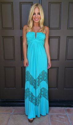 """SKY always brings the pretty! Channel your inner bohemian princess in this gorgeous maxi dress by SKY. This premium strapless maxi dress features chevroned crochet lace detailing close to the hem of the dress and a wired and shirred bust for extra support.   Model is 5'4"""" and is wearing a size small."""
