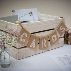 whitewashed wooden crate with a burlap banner