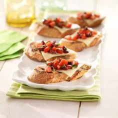 Grilling the bread adds a gourmet touch to this easy summer appetizer with fresh tomatoes, olives and cheese.
