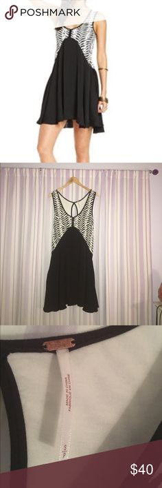 Free People Animal Print Sleeve Dress Adorable summer Free People dress. Zebra print v neck top and a black flowy bottom. HAS POCKETS. Only worn twice, great condition. Free People Dresses Midi