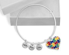 """Autism Puzzle Piece Heart Chunky Charm Bracelet. Autism Bracelet  One brand new retractable colored puzzle piece heart charm bracelet  Bracelet size: 8 1/2 inches  Charm: 1 inch tall x 1 inch wide  Word Charms: 3/8 in diameter This sterling silver plated autism awareness retractable charm bracelet has a colored puzzle piece heart charm. The autism heart charm is 1 inch tall by 1 inch wide. The bracelet has three 3/8 inch diameter silver word charms that read """"Faith"""" """"Hope"""" """"Love"""". The…"""