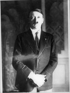 Adolf Hitler in September, 1931 in Munich. This is a test shot from his personal photographer, Heinrich Hoffmann, and shows Hitler in striped pants and a forest green Bavarian jacket (the piping was red). Hitler never wore this jacket in public, he only wore it on the Obersalzberg.