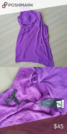 BCBG Dress Purple BCBG Flowy Off the shoulder dress. New with tags never worn. Very grecian goddess style dress. Bought for an event we didn't attend. I am downsizing my closet.  ??If you are interested- please make me an offer! And bundle to save!!!! All reasonable offers will be accepted?? Happy Shopping! BCBGMaxAzria Dresses One Shoulder