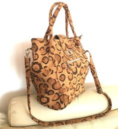 This wonderful shoulder bag, handbag is made from printed cork. Perfectly finished, High Quality, durable and waterproof. This bag can be a great gift.      Features:    - Made from Cork-Eco-friendly material    - Soft and durable    - One color      External size    23 x 25 x 15cm      How to clean cork?    - Cork is stain and water resistant.    - Cork is very easy to maintain as new, just need to clean with a dump soft cloth.      *Colours may differ slightly from the original due to the…