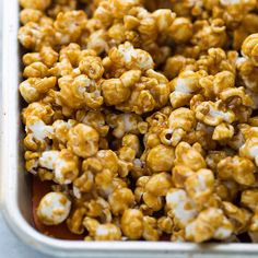 The BEST Homemade Caramel Corn!  Every piece is sweet, a little salty and perfectly crispy. #caramelcorn #homemadecaramelcorn #halloweenfood #halloweentreat #caramelcornrecipe