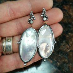 Mother of Pearl and diamond earrings.  #motherofpearl #iridescence #jewelry #jewelrygram #instajewelry #jewelrygram #silversmith #gold #gemstone #silver #bangles #peridot #pearl #joia #joyas #joyería #gioielli #bijoux #Schmuck #gemstone #happy #black #white #handmade
