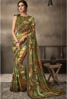 Latest Green Georgette Flower Printed And Fancy Lace Border Daily Wear Saree Product Details : Get a divalicious look wearing this beige color daily wear saree. Crafted of georgette fabric, this saree comes with unstitched raw silk blouse piece. Georgette Fabric, Georgette Sarees, Silk Fabric, Silk Sarees, Fancy Sarees, Party Wear Sarees, Saree Floral, Saree Jewellery, Green Saree