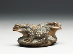 Netsuke in the form of two toads on a sandal.  Ashmolean Museum.