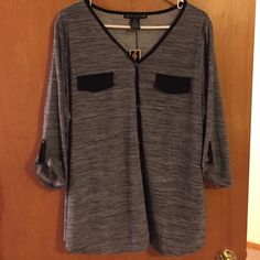 Super cute grey black 3/4 sleeve top Has faux buttons and faux pockets in the front. Super cute slinky material, 3X true to size. 3/4 sleeve. Tops