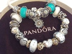 PANDORA Bracelets with White,  Aqua Blue and Gold.