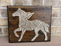 String Art - Horse Available on my Etsy shop NailedITCA.  Check it out to see other pieces that are available.