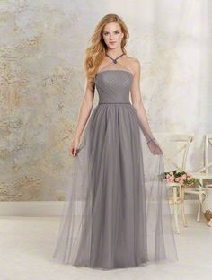 Alfred Angelo Style 8621L: Soft net full length bridesmaid dress with a gathered bodice, sheer halter neckline and pearl beaded straps
