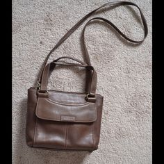 """Fossil cross body bag Beautiful Fossil cross body bag. New condition!Genuine fossil leather..  Brass toned hardware. Measures 10 1/2"""" x 8"""" shoulder drop 19""""..Hand drop 5"""". Very cool looking with plenty of rooms and pockets in the inside. Even has front wallet like pockets as can be seen in picture. Fossil Bags Crossbody Bags"""