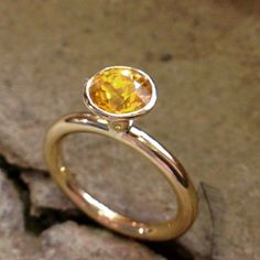 Arum cocktail ring by Rachel Jeffrey. 18ct gold and yellow sapphire
